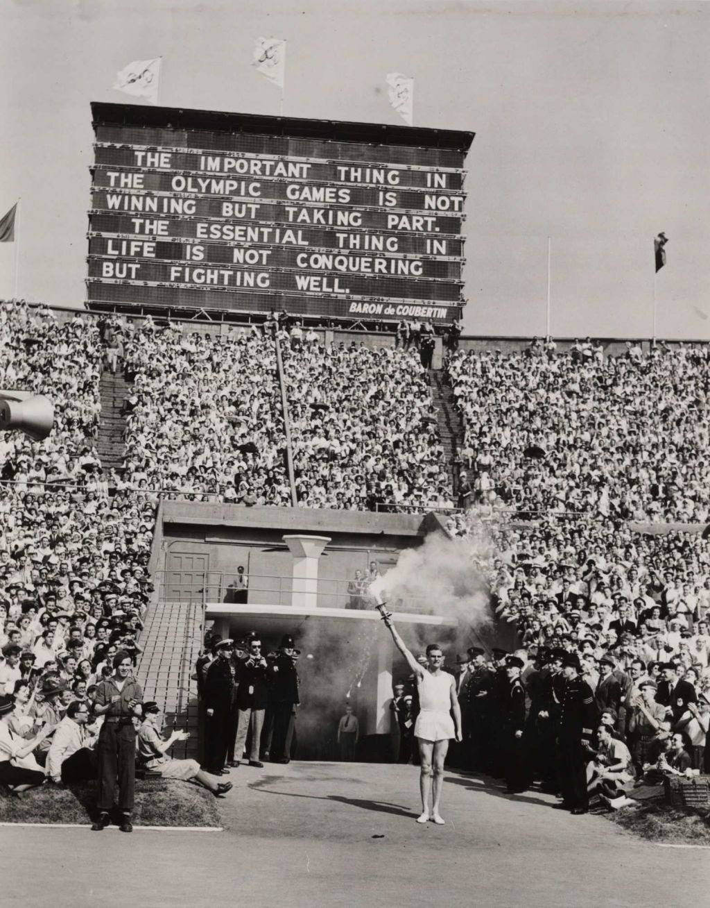 Torch-bearer arrives at opening ceremony, Olympic Games, London, 1948. National Media Museum, No known Copyright, https://www.flickr.com/photos/nationalmediamuseum/7649949614/